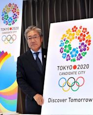 "Tsunekazu Takeda, president of the Tokyo 2020 bid committee, presents its slogan ""Discover Tomorrow"" and its logo in Tokyo last week. Tokyo, the only one of the three to have previously hosted the Games back in 1964, Istanbul and Madrid will learn their fate in Buenos Aires on September 13 next year when International Olympic Committee members vote"