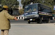 Indian police guide a prisoner transport vehicle at an entrance to the Saket District Court in New Delhi on January 10, 2013 ahead of the hearing of a gang-rape and murder case. A lawyer for the defendants in the New Delhi gang-rape case accused police on Thursday of beating confessions out of them as they appeared for their second court appearance