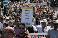 Municipality workers march in central Athens on Wednesday as part of a 48-hour strike against spending cutbacks and the government's latest austerity measures. The sign in the foreground reads 'No sacrifies for the Euro'