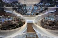 Traders work at the stock exchange in Frankfurt/M., western Germany. Despite making progress, the eurozone debt crisis remains unsolved and, in a repeat of last summer, could still bring nasty surprises to global stock markets in July and August, analysts said