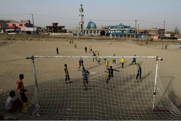 Afghan youths play football at a field in the outskirts of Kabul in September. Japan's 2018 World Cup qualifiers against the country and also Syria will be played on neutral ground due to security
