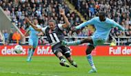 Manchester City's Yaya Toure (R) scores his second goal during the Premier League match against Newcastle on May 6. City moved to within touching distance of a first English league title in 44 years after Toure scored twice in a 2-0 win