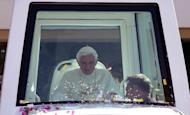 A handout picture released by the Lebanese photo agency Dalati and Nohra shows Pope Benedict XVI arriving in his popemobile at the presidential palace of Baabda, east of the Lebanese capital Beirut