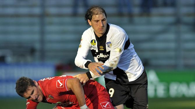 Parma's Gabriel Paletta of Argentina, right, vies for the ball with Catania's Gonzalo Bergessio of Argentina, during their Serie A soccer match at Parma's Tardini stadium, Italy, Sunday, Feb. 9, 2014