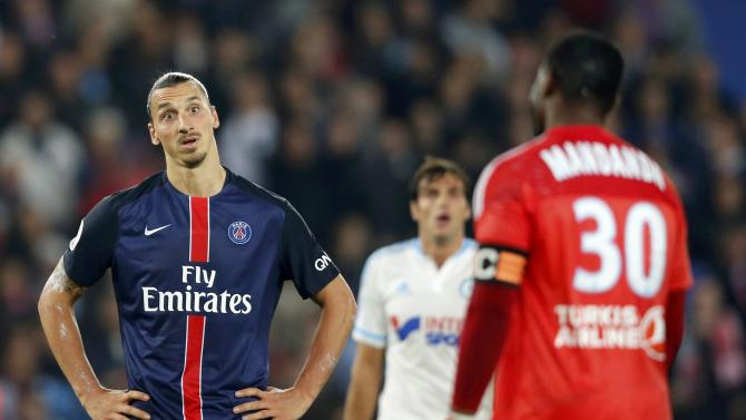 Paris St Germain's Ibrahimovic argues with Olympique Marseille goalkeeper Madanda during their  French Ligue 1 soccer match at the Parc des Princes stadium in Paris
