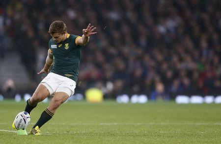 Pat Lambie of South Africa kicks a penalty during their Rugby World Cup Semi-Final match against New Zealand at Twickenham in London