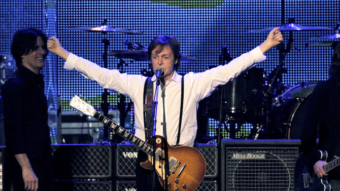 """FILE - This Feb. 10, 2012 file photo shows Paul McCartney performing at the MusiCares Person of the Year gala in his honor in Los Angeles.  McCartney will play on a 1877 Steinway grand piano he discovered and had refurbished at Detroit's Motown Museum. Word came down late Wednesday, Aug. 29, that the new and improved 9-foot Victorian rosewood will have its coming-out party at a Sept. 18 charity event in New York City before returning to its home on West Grand Boulevard in Detroit. McCartney and Motown founder Berry Gordy will play the piano at the New York event, dubbed """"Project: Harmony.""""  (AP Photo/Chris Pizzello, file)"""