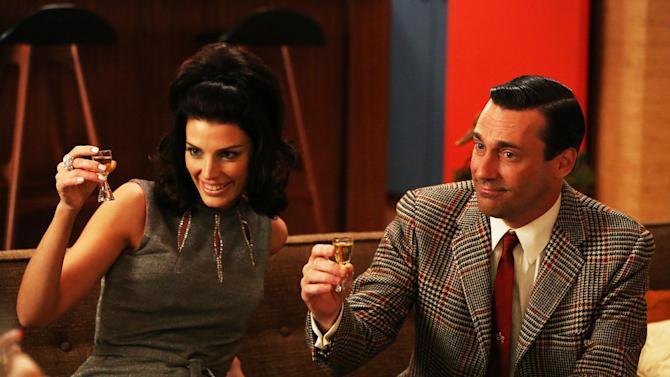 "This publicity photo provided by AMC shows Jessica Pare as Megan Draper, left, and Jon Hamm as Don Draper in a scene of ""Mad Men,"" Season 6, Episode 2. ""Mad Men"" returns for its sixth season Sunday, April 7, 2013. (AP Photo/AMC, Michael Yarish)"
