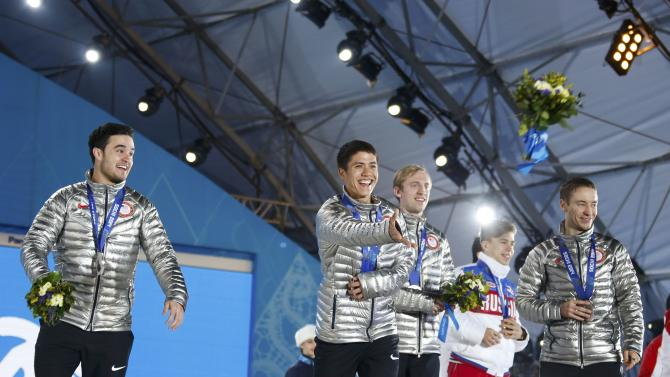 Silver medallists U.S. Alvarez, Celski, Creveling and Malone celebrate during the victory ceremony for the men's 5,000 metres relay short track speed skating event at the 2014 Sochi Winter Olympics in Sochi