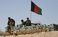 Afghan national army soldiers are shown at their base in Musa Qala district in Helmand province in 2010. Taliban Islamist insurgents beheaded 17 party-goers, 10 Afghan soldiers were killed and two NATO troops shot dead in a new insider attack in a bloody day across Afghanistan, officials said Monday