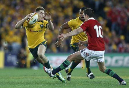 Australia Wallabies' James O'Connor avoids the tackle of British and Irish Lions' Jonathan Sexton during their third and final rugby union test match at ANZ stadium in Sydney