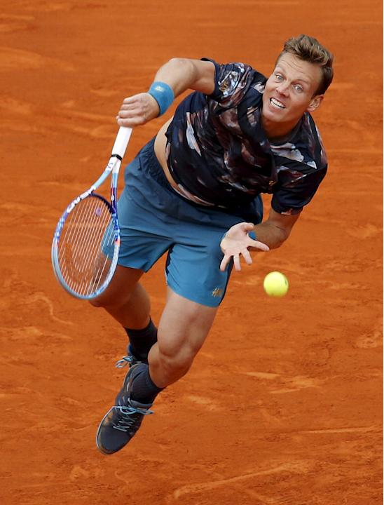 Tomas Berdych of the Czech Republic serves to Novak Djokovic of Serbia during their final tennis match at the Monte Carlo Masters in Monaco