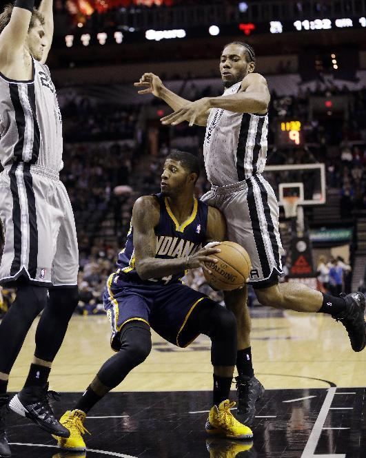 Indiana Pacers' Paul George, center, is pressured by San Antonio Spurs' Tiago Splitter, left, of Brazil, and Kawhi Leonard, right, during the first half of an NBA basketball game, Saturday, Dec. 7, 2013, in San Antonio