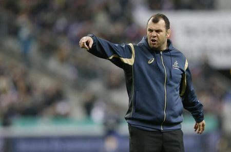 Australian Wallabies head coach Cheika directs his players during the warm up before the rugby union test match against France at the Stade de France in Saint-Denis