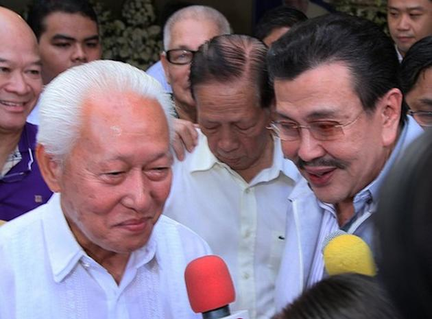Former president Joseph Estrada (R) and Manila City Mayor Alfredo Lim (L) greet each other during a ceremony to commemorate the death anniversary of a mutual friend, the late actor Fernando Poe Jr., in Manila, 14 December 2012. Estrada and Lim are both running for Manila mayorship in the coming May 2013 elections. (Paulo Vecina/NPPA Images)