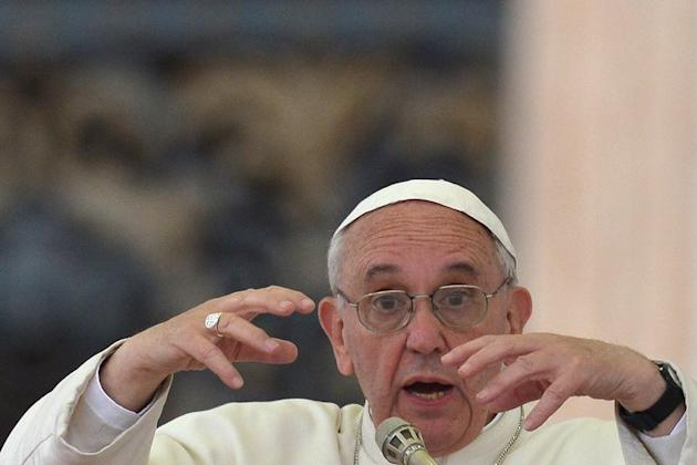 Pope Francis leads the Pentecost ceremony at St Peter's Square on May 18, 2013. The Vatican has denied the pontiff performed an exorcism after an Italian religious television channel said footage of the pontiff blessing a boy in a wheelchair showed he had
