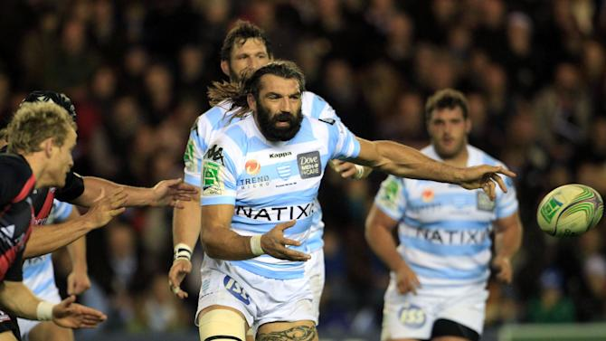 Racing Metro's Sebastian Chabel, of France, centre, in action against Edinburgh, during the Heineken Cup rugby match at Murrayfield, Edinburgh, Friday Nov. 18, 2011.  (AP Photo / Lynne Cameron, PA) UNITED KINGDOM OUT - NO SALES - NO ARCHIVES