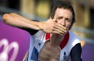 Britain's Bradley Wiggins approaches the finish line to win the gold medal after competing in the London 2012 Olympic Games men's individual time trial road cycling event in London