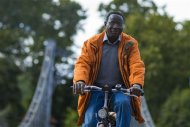 Halle constituency candidate of the Social Democratic Party (SPD) Karamba Diaby cycles in a park in the eastern city of Halle, September 14, 2013. REUTERS/Thomas Peter
