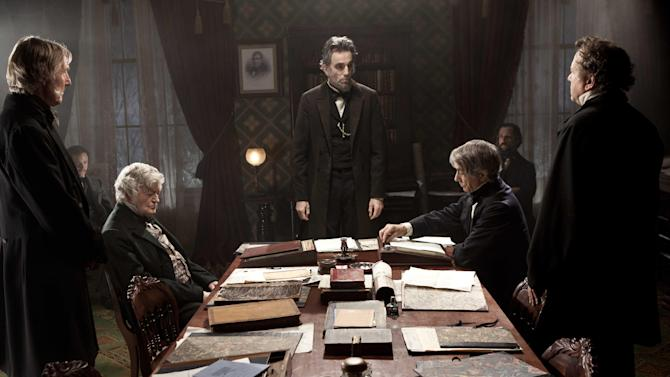 "FILE - This undated publicity photo released by DreamWorks and Twentieth Century Fox shows, Daniel Day-Lewis, center rear, as Abraham Lincoln, in a scene from the film, ""Lincoln.""  Day-Lewis, who plays the 16th president in Steven Spielberg's epic film biography ""Lincoln,"" settled on a higher, softer voice, saying it's more true to descriptions of how the man actually spoke. ""Lincoln"" opened in limited release Nov. 9, 2012, and expands nationwide Friday, Nov. 16. (AP Photo/DreamWorks, Twentieth Century Fox, David James, File)"