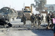 US soldiers arrive at the site of a suicide attack near the gate of Kandahar international airport on January 19. A suicide bomber attacked foreign military forces in northern Afghanistan on Wednesday, killing at least 12 people including three international troops, officials said