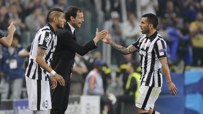Football: Juventus' Carlos Tevez shakes hands with coach Massimiliano Allegri as he is substituted for Roberto Pereyra