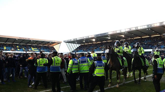 Football Association to investigate on-pitch disturbances that overshadowed Millwall's FA Cup win against Leicester