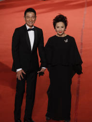 Hong Kong actor Andy Lau, left, and actress Deanie Ip arrive at the 48th Golden Horse Awards in Hsinchu, north eastern Taiwan. The Golden Horse Awards is one of the Chinese-language film industry's biggest annual events.(AP Photo/Wally Santana)