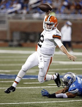 Browns quarterback Johnny Manziel (2) escapes diving Lions outside linebacker Kyle Van Noy (95) in the second half Saturday. (AP Photo)