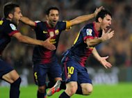 Barcelona's Lionel Messi (R) celebrates after scoring his second goal during their Spanish La Liga match against Real Madrid, on October 7, at the Camp Nou stadium in Barcelona. League leaders Barca have few worries as they go to Deportivo La Coruna on Saturday, looking to make it four wins from four on the road