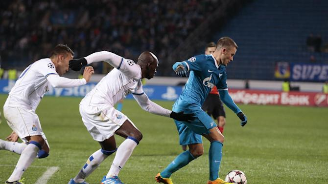 Zenit's Viktor Fayzulin, right, shields the ball from Porto's Nicolas Otamendi, left, and Porto's Eliaquim Mangala during the Champions League group G soccer match between Zenit and Porto at Petrovsky stadium in St.Petersburg, Russia, on Wednesday, Nov. 6, 2013