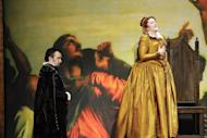 In this April 18, 2012, photo provided by the Houston Grand Opera, Robert Gleadow, left, performs in the Houston Grand Opera's production of Maria Stuarda, with Katie Van Kooten, right, in Houston. Van Kooten, an imposing soprano, plays the part of Elizabeth in the show. (AP Photo/Houston Grand Opera)