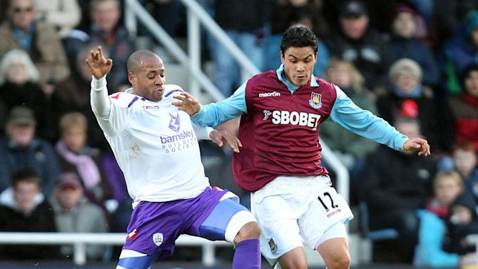 West Ham United's Pablo Barrera, right, controls the ball away from Barnsley's Matt Hill during the English FA Cup third round soccer match at Upton Park, London, Saturday Jan. 8, 2011. West Ham won 2-0. (AP Photo/PA, Matthew Impey) UNITED KINGDOM OUT  NO INTERNET/MOBILE USAGE WITHOUT FAPL LICENCE - SEE IPTC SPECIAL INSTRUCTIONS FIELD FOR DETAILS