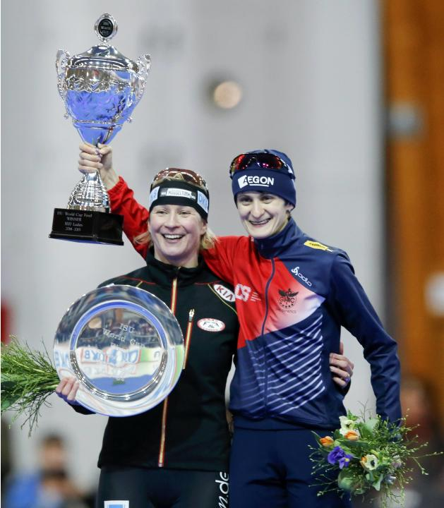 Germany's second placed Pechstein and Czech Republic's winner Sablikova pose with their trophies after the women's 3000m speed skating ISU World Cup Speed Skating Fina