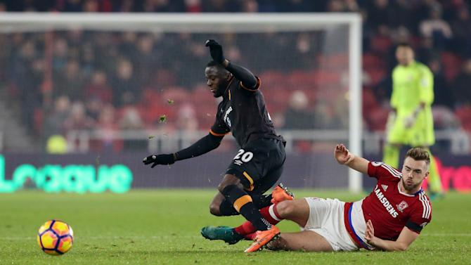 Middlesbrough's Calum Chambers in action with Hull City's Adama Diomande