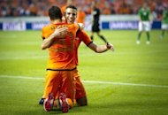 Dutch Robin van Persie (back) celebrates with teammate Ibrahim Afellay after the latter scored against Northern Ireland in Rotterdam. Inspired by an impressive van Persie, the Netherlands finished their Euro 2012 preparations in fine style by thrashing Northern Ireland 6-0 in Amsterdam