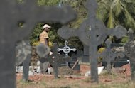 Workers prepare the gravesite of Jacintha Saldanha at a cemetary in Shirva on December 16, 2012. Family and friends of Saldanha, the nurse who was found hanged after taking a hoax call to the hospital treating Prince William's wife, prepared for her funeral in India on Monday.
