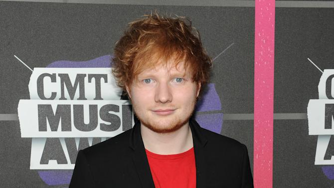 """FILE - This June 5, 2013 file photo shows British singer-songwriter Ed Sheeran at the 2013 CMT Music Awards at Bridgestone Arena in Nashville, Tenn. Sheeran moved to Nashville in February, settling just outside of town in a rural area. """"I wanted to live somewhere that like incorporated a lot of music, was relaxed, had a lot of countryside, but also wasn't filled with dicks,"""" Sheeran said. """"And Nashville is full of very, very nice people."""" (Photo by Frank Micelotta/Invision/AP, file)"""