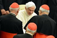 Pope Benedict XVI greets cardinals in October at the Paul VI hall in the Vatican. Six non-European prelates are set to join the Catholic Church's College of Cardinals on Saturday, a move welcomed by critics concerned that the body which will elect the future pope is too Eurocentric.