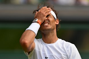 Spain's Rafael Nadal reacts after a point against Germany's Dustin Brown during their men's singles second round match on day four of the 2015 Wimbledon Championships at The All England Tennis Club in Wimbledon, southwest London, on July 2, 2015 (AFP Photo/Glyn Kirk)