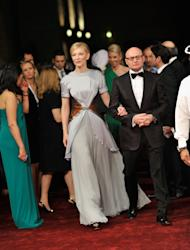 """DUBAI, UNITED ARAB EMIRATES - DECEMBER 09: Actress Cate Blanchett and IWC Schaffhausen CEO George Kern attend the """"Life of PI"""" Opening Gala during day one of the 9th Annual Dubai International Film Festival held at the Madinat Jumeriah Complex on December 9, 2012 in Dubai, United Arab Emirates. (Photo by Gareth Cattermole/Getty Images for DIFF)"""