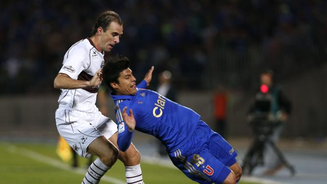 Felipe Gallegos of Chile's Universidad de Chile fights for the ball with Leandro Somoza of Argentina's Lanus during their Copa Sudamericana soccer match in Santiago