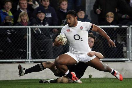 England's Tuilagi is tackled by New Zealand All Blacks Smith during their second rugby union test match at Forsyth Barr Stadium in Dunedin