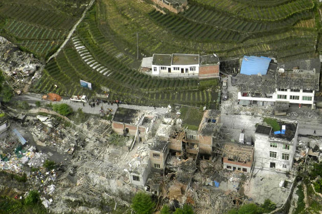 This aerial photo released by China's Xinhua news agency shows destroyed houses after a powerful earthquake hit Taiping town of Lushan County in Ya'an City, southwest China's Sichuan Province, Saturda