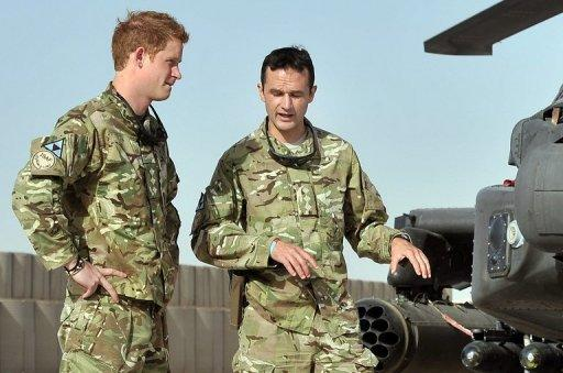Prince Harry (L) is shown the Apache flight-line by a member of his squadron at Camp Bastion in Afghanistan's Helmand province on September 7. The Taliban said Monday it was determined to kill Harry, who is currently serving in Afghanistan.