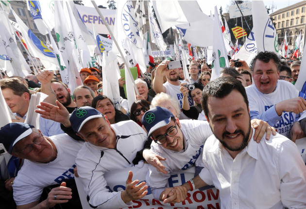 Italian Lega Nord (Northern League) party Matteo Salvini, second right, poses for pictures with supporters during a protest to demand the Italian government keep out immigrants in Rome, Saturday, Feb.