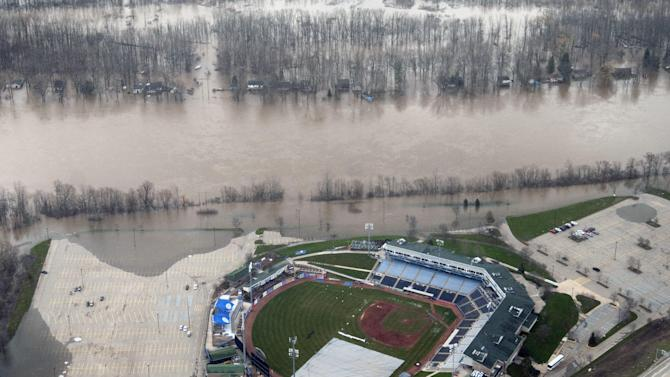 This aerial photo shows  flooded homes and FifthThird Ballpark along the Grand River north of downtown Grand Rapids, Mich. Saturday, April 20, 2013. Grand Rapids Mayor George Heartwell has declared a state of emergency as the city deals with rising waters. (AP Photo/The Grand Rapids Press, Chris Clark ) ALL LOCAL TV OUT; LOCAL TV INTERNET OUT