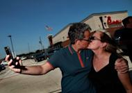 """A couple kiss outside a Chick-fil-A restaurant on August 3, in Dallas, Texas. Gays and lesbians puckered up at """"kiss-ins"""" outside Chick-fil-A outlets across the United States in protest over the fast-food chain's opposition to same-sex marriage"""