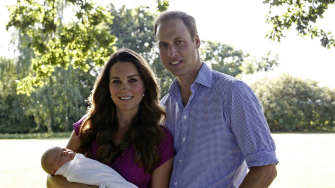 This image taken by Michael Middleton, father of Kate, the Duchess of Cambridge, in early August 2013 and provided by Kensington Palace, shows the Duke and Duchess of Cambridge with their son, Prince George, in the garden of the Middleton family home in Bucklebury, England. (AP Photo/Michael Middleton/TRH The Duke and Duchess of Cambridge)