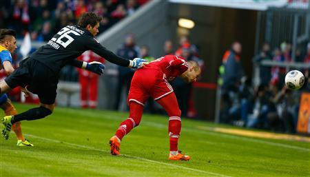Braunschweig's goalkeeper Davari fails to save the ball while Bayern Munich's Robben scores during their German first division Bundesliga soccer match in Munich